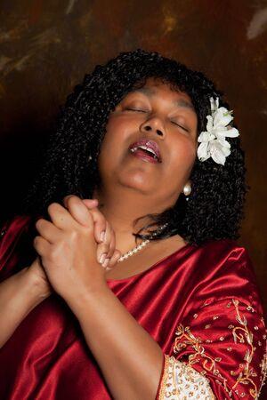 hymnal: spiritual gospel singer singing a hymn Stock Photo