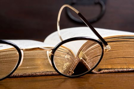 Antique glasses in front of an old gold edged book Stock Photo - 5097561