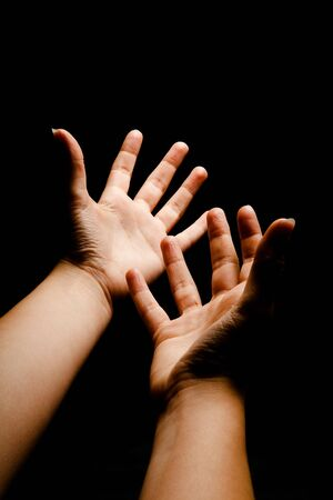 Hands in outer space reaching into the darkness Stock Photo - 5097529