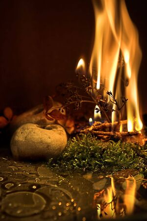 omen: Fire burning, reflected in a water pool Stock Photo