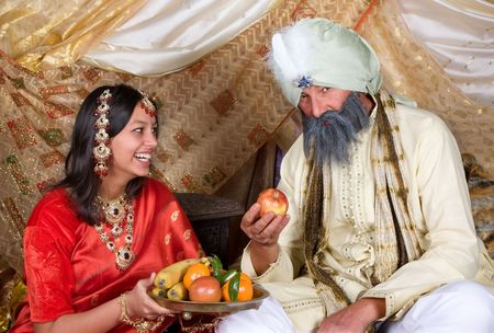 Indian beauty offering fruit to her father the maharaja photo