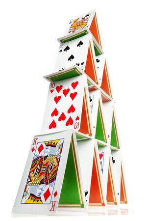instability: Low angle photo of a 4 layer house of cards Editorial