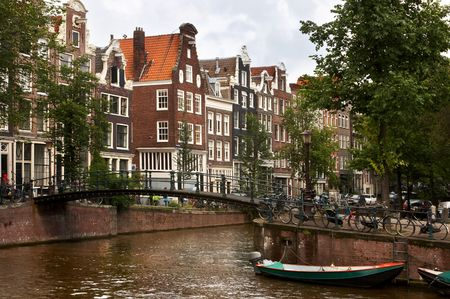 Bikes and boats and 17th century houses in Amsterdam photo