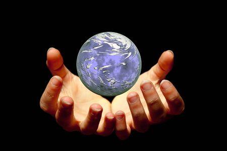 Female hands holding a brilliant globe in the dark Stock Photo - 5185677