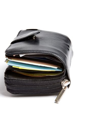 creditcards: Tightly filled black leather wallet of a businessman Stock Photo