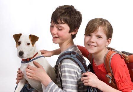 Teenager kids posing with their dog and schoolbags Stock Photo - 5213844