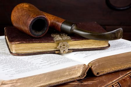 Old pipe lying on antique gold edged books Stock Photo - 5244670
