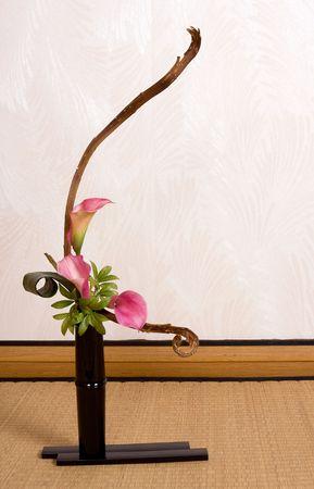 Ikebana flower arrangement on a tatami mat in a japanese home photo
