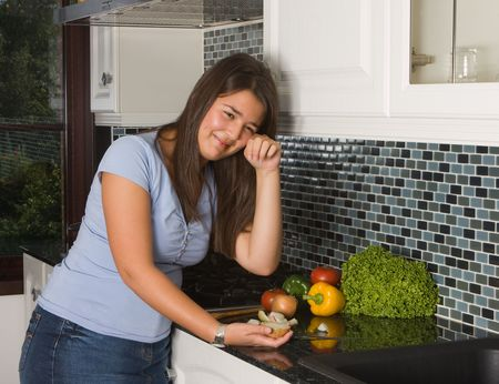 Young woman crying tears while cutting an onion Stock Photo - 5237145