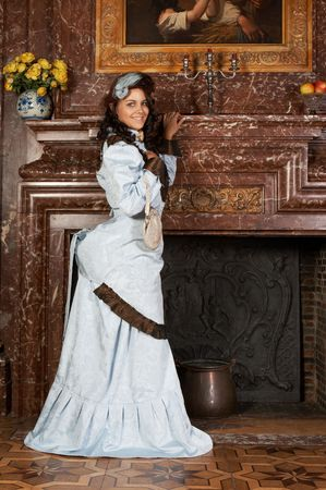 Portrait of a beautiful young victorian lady in a genuine bustle dress.