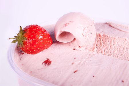 Homemade strawberry ice cream and one nice curl Stock Photo - 5329267