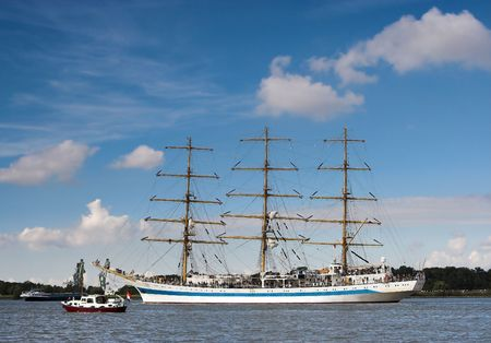 Three-masted ship sailing on the river Scheldt in Antwerp harbor during the Tall Ships Race of 2006 photo