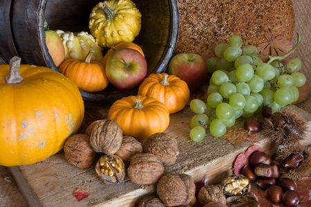 pilgrims: Table and wooden board filled with autumn products