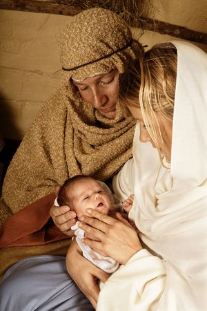 bethlehem crib: Reenactment of the christmas nativity scene with real people Stock Photo