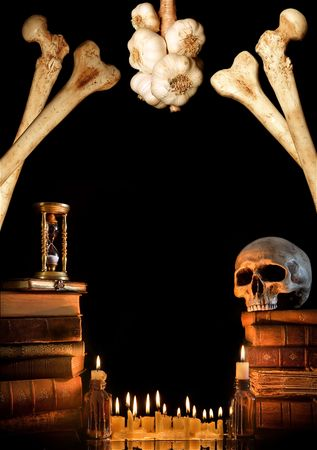 Halloween border with skull, ancient books and candles Stock Photo - 5428861