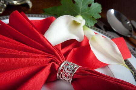 napkin ring: Ornate silver napkin ring on an elegant dinner table Stock Photo