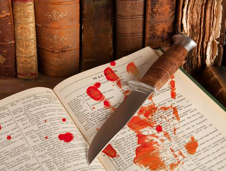Shakespeare's Macbeth with old books and a blood hand Stock Photo - 5428841