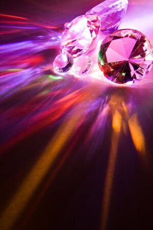 Dispersion of light through crystals into rainbow colors photo