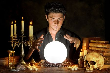 superstitions: Halloween scene of a young sorcerer and his crystal ball
