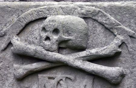 catacomb: Crossbones carved in a tombstone