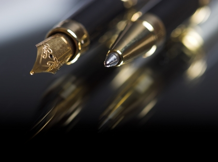 ballpoint: Pen and ballpoint reflected on a shiny surface