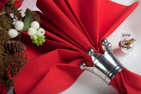 Festive Christmas or wedding table with red napkins on a white tablecloth Stock Photo - 5506309