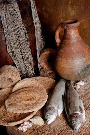loaves: Vintage still life of fresh fish with loaves of bread and an antique wine jar Stock Photo