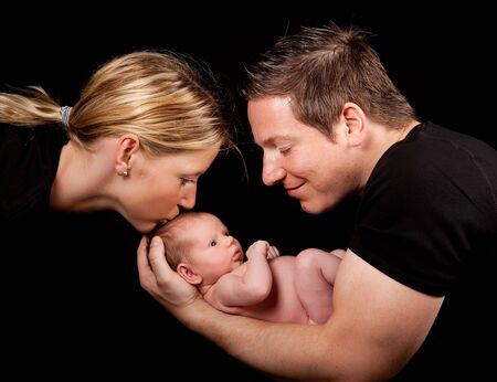 Family portrait of newborn baby father and mother photo