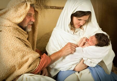 saint joseph: Living christmas nativity scene reenacted with a real 18 days old baby