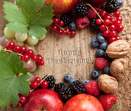 Border frame for thanksgiving made of fresh autumn fruits photo