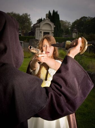 Victorian lady defending herself against an evil monk at halloween Stock Photo - 5565806