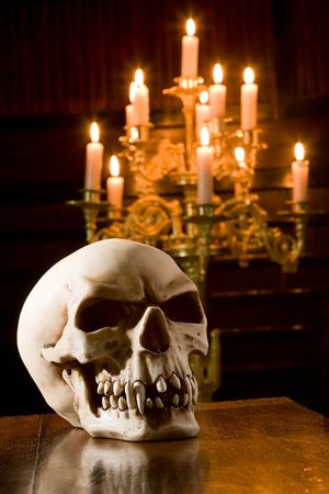 cemeteries: Spooky skull lit by candles in a chapel