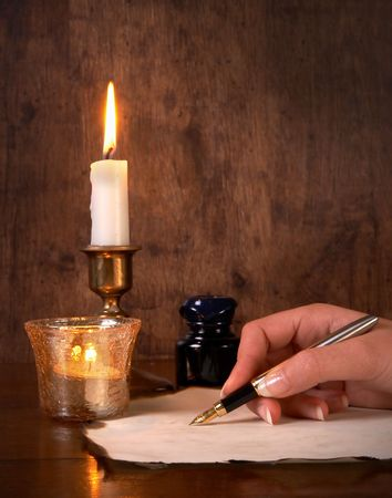 Hand writing on parchment with a golden pen Stock Photo - 5601663