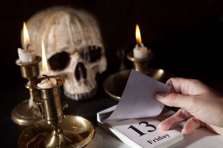 Friday 13th on a calendar with candles and a creepy skull Stock Photo - 5601664