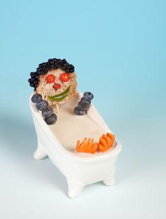 funny food: Funny food face in a bathtub full of milk