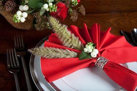 napkin ring: Festive red decorated napkin with ornate sterling silver napkin ring