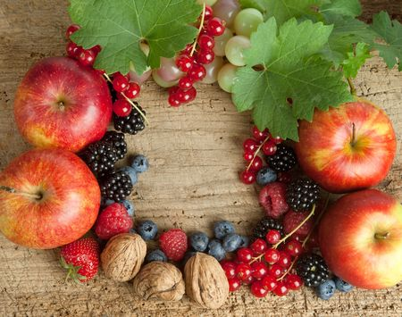 Thanksgiving border made of autumn fruits on a wooden board photo