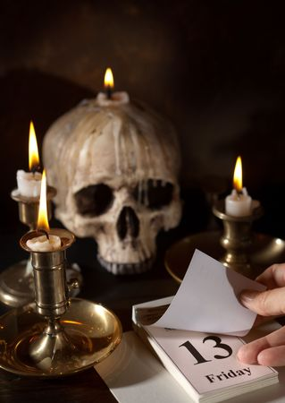 13th: Friday 13th on a calendar with candles and a creepy skull