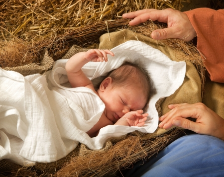 nativity: 20 days old baby sleeping in a christmas nativity crib