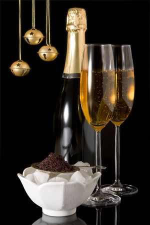russian food: Champagne glasses and caviar with christmas bells