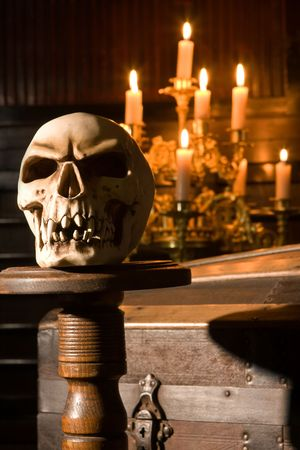Spooky kull lit by candles in gothic surroundings Stock Photo - 5722238