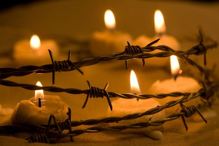 af: Burning candles in barbed wire, symbol of hope and freedom Stok Fotoğraf