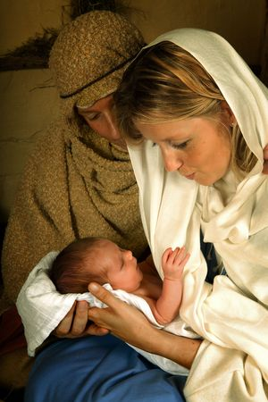 baby jesus: Reenactment of the christmas nativity scene with real people Stock Photo