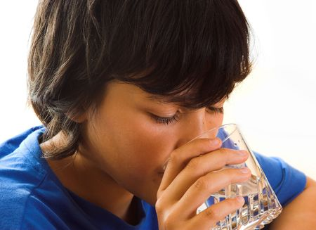Boy drinking a glass of water Stock Photo - 5719796