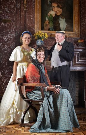 Vintage portrait of a victorian family in the interior of Castle