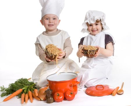 Boy and girl playing with spaghetti and food photo