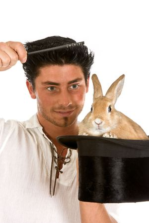 Little rabbit in a top hat and a young man with a magic wand Stock Photo - 5766182