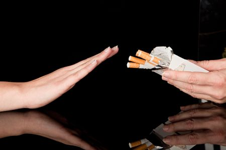 refusing: Hand refusing the cigarettes offered to her Stock Photo