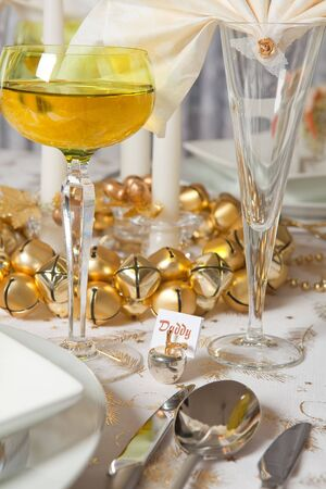 Elegant Christmas dinner table with fancy napkins and crystal glasses photo