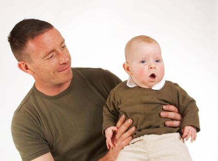 Soldier father holding his four month old baby boy photo